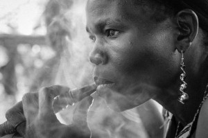 Woman smoking, Kajo Keji, South Sudan