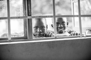 Portrait of boys looking on, Kajo Keji Cathedral, South Sudan